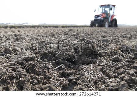 farmer in tractor - stock photo