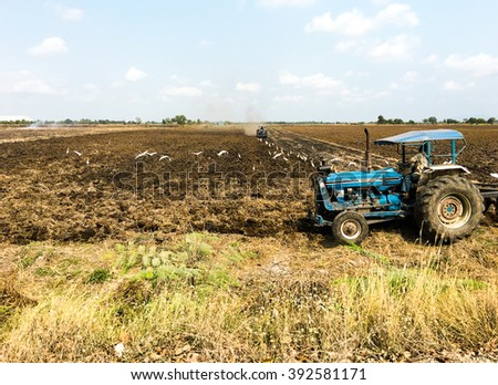 Farmer in tractor preparing farmland with seedbed for the next year,Thailand