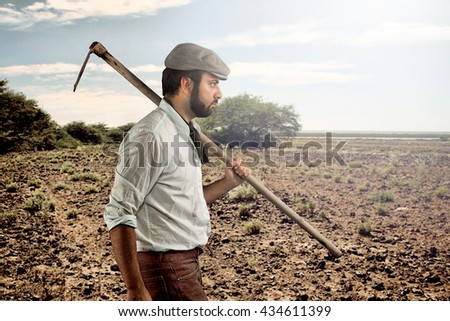 Farmer of the late nineteenth century walking through the fields - stock photo