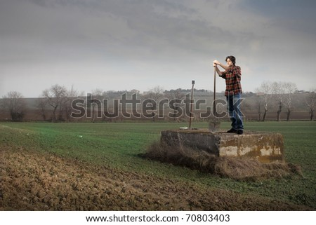 Farmer on a cultivated field - stock photo