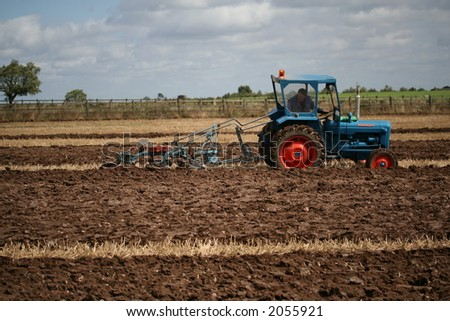 Farmer ploughing field in traditional way