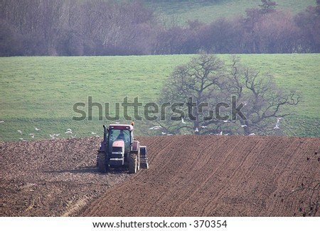 Farmer ploughing his field - stock photo