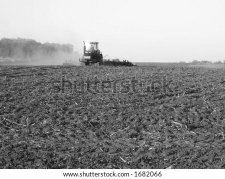 farmer ploughing his field - Southwestern Ontario - stock photo