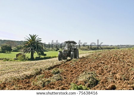 Farmer ploughing with the tractor