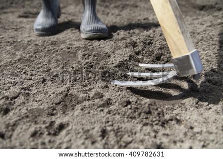 farmer plowing field  - stock photo
