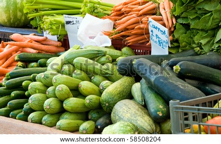 Farmer's market vegetable stand with fresh picked produce - stock photo