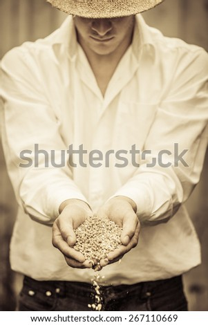 Farmer Showing Animal Dry Food Falling of its hands - stock photo