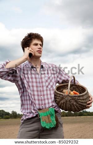 farmer speaking on the phone - stock photo