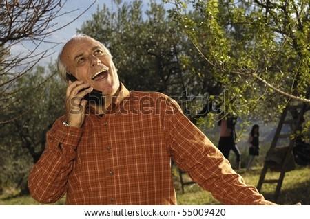 farmer talking at phone - stock photo