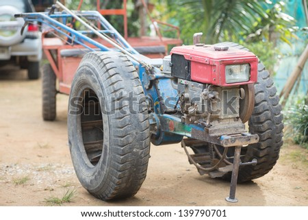 Farmer tractor - stock photo