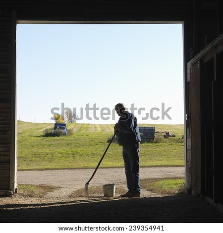 Farmer with Pitchfork - stock photo