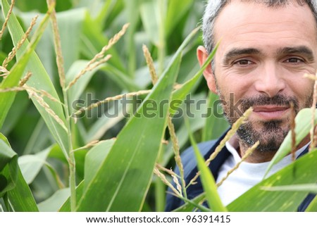 farmer working in the field - stock photo