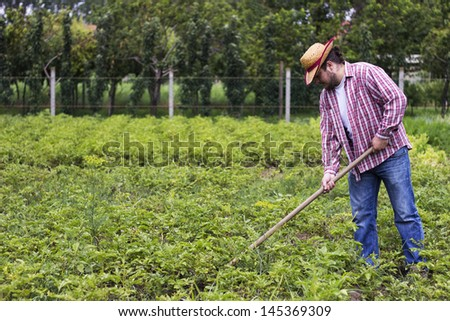 farmer working on his farm - stock photo