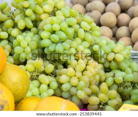 Farmers market seller selling fresh local produce - stock photo