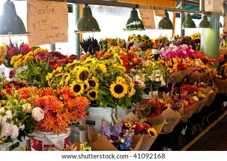 Farmers' markets, sometimes called greenmarkets, are markets, usually held out-of-doors, in public spaces, where farmers can sell produce to the public. - stock photo
