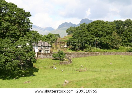 Farmhouse and rural landscape in the English Lake District National Park. - stock photo