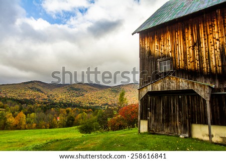 Farmhouse in fall - stock photo