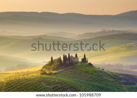 Farmhouse in Tuscany. Early morning countryside - stock photo