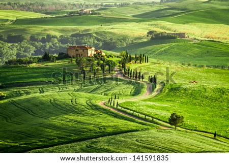 Farmhouse in Tuscany located on a hill - stock photo