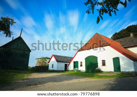 Farmhouse with dramatic sky