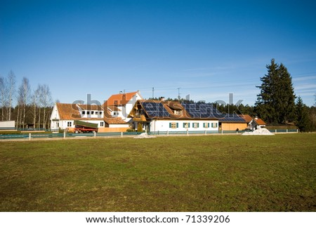 Farmhouses, complete with solar panels, Germany - stock photo