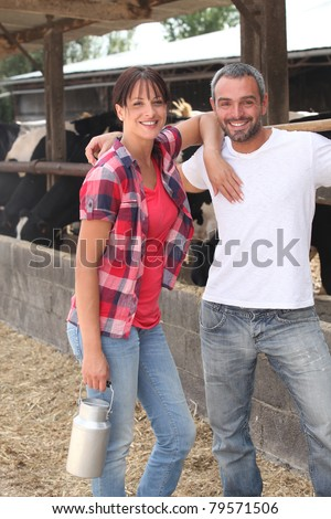 Farming couple with cows