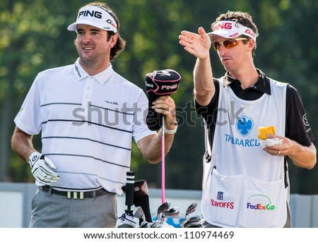 FARMINGDALE, NY - AUGUST 22: Bubba Watson prepares to hit a drive at Bethpage Black during the Barclays on August 22, 2012 in Farmingdale, NY. - stock photo