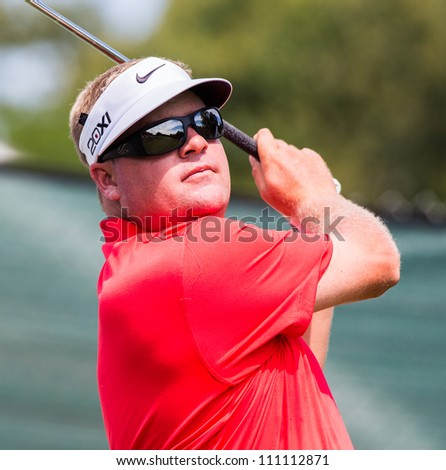 FARMINGDALE, NY - AUGUST 21: Carl Pettersson hits a shot at Bethpage Black during the Barclays on August 21, 2012 in Farmingdale, NY. - stock photo