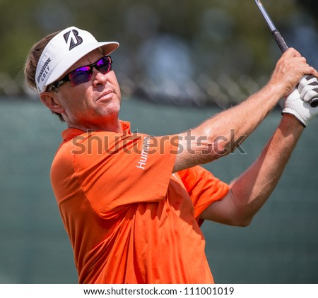 FARMINGDALE, NY - AUGUST 21: Davis Love hits a drive at Bethpage Black during the Barclays on August 21, 2012 in Farmingdale, NY. - stock photo