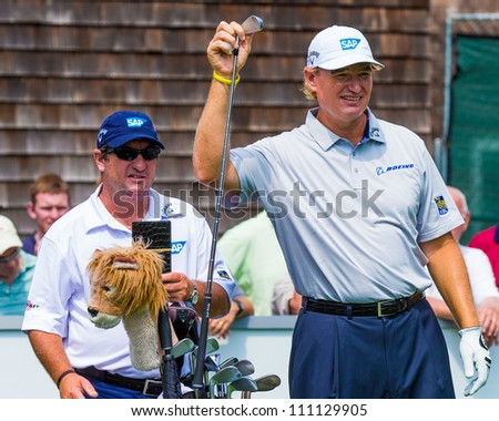 FARMINGDALE, NY - AUGUST 22: Ernie Els prepares to hit a shot at Bethpage Black during the Barclays on August 22, 2012 in Farmingdale, NY. - stock photo