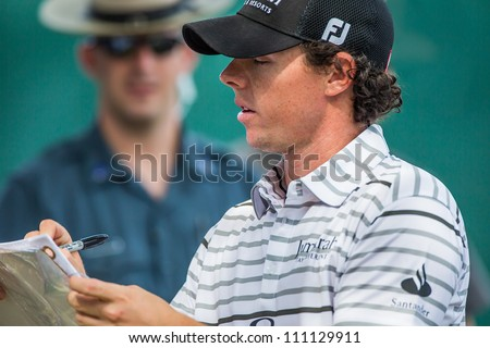 FARMINGDALE, NY - AUGUST 21: Rory McIlroy signs autographs at Bethpage Black during the Barclays on August 21, 2012 in Farmingdale, NY.