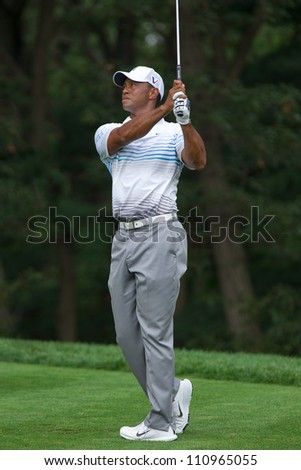 FARMINGDALE, NY - AUGUST 22: Tiger Woods hits a tee shot off the 14th hole at Bethpage Black during the Barclays on August 22, 2012 in Farmingdale, NY. - stock photo