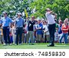FARMINGDALE, NY - JUNE 15: Adam Scott hits his drive while Lee Westwood and Rory McIlroy look on during the 2009 US Open on June 15, 2009 in Farmingdale, NY. - stock photo