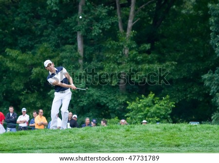 FARMINGDALE, NY - JUNE 16: Columbian Camilo Villegas chips onto the 4th hole on Bethpage Black during the 2009 US Open on June 16, 2009 in Farmingdale, NY. - stock photo
