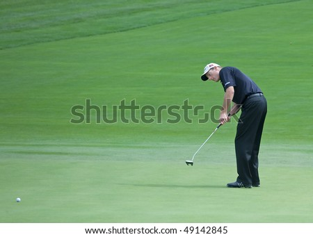 FARMINGDALE, NY - JUNE 15: Jim Furyk putts on the 12th hole on the Black Course during the 2009 US Open on June 15, 2009 in Farmingdale, NY. - stock photo