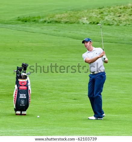 FARMINGDALE, NY - JUNE 16: Long hitting Dustin Johnson prepares to hit a shot during the 2009 US Open on June 16, 2009 in Farmingdale, NY. - stock photo