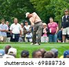 FARMINGDALE, NY - JUNE 16: Matt Kuchar hits his drive on Bethpage Black during the 2009 US Open on June 16, 2009 in Farmingdale, NY. In 2010 he was the leading money winner. - stock photo