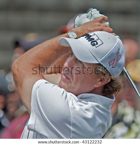 FARMINGDALE, NY - JUNE 17: Phil Mickelson at the 2009 US Open on June 17, 2009 in Farmingdale, NY. The pink ribbon symbolizes awareness for breast cancer research his wife and mother are battling. - stock photo