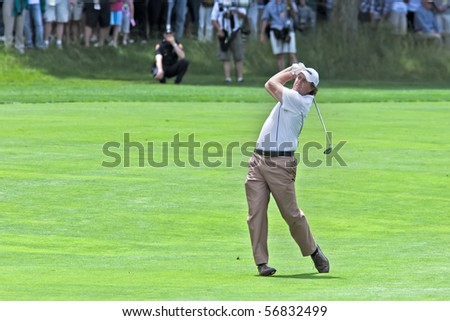FARMINGDALE, NY - JUNE 17: Phil Mickelson hits his second shot on the par 5 fourth hole on Bethpage Black during the 2009 US Open on June 17, 2009 in Farmingdale, NY. - stock photo