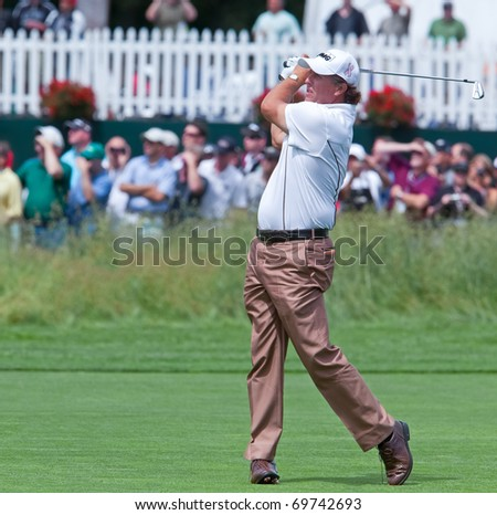 FARMINGDALE, NY - JUNE 17: Phil Mickelson hits his second shot on the par 4 16th hole on Bethpage Black during the 2009 US Open on June 17, 2009 in Farmingdale, NY. - stock photo