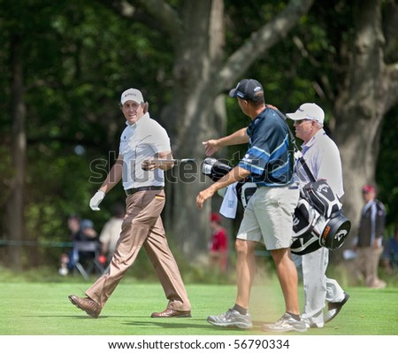 FARMINGDALE, NY - JUNE 17: Phil Mickelson with his caddy and instructor, Butch Harmon, during the 2009 US Open on June 17, 2009 in Farmingdale, NY. - stock photo