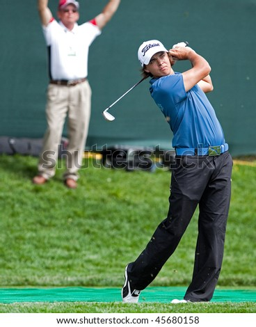 FARMINGDALE, NY - JUNE 17: Rookie Rickie Fowler tees off the 17th hole on the Black course at Bethpage State Park during the 2009 US Open on June 17, 2009 in Farmingdale, NY. - stock photo