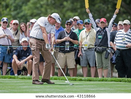 FARMINGDALE, NY - JUNE 17: Spectators enjoy watching Phil Mickelson hit a drive on the second hole at the black course during the 2009 US Open on June 17, 2009 in Farmingdale, NY. - stock photo