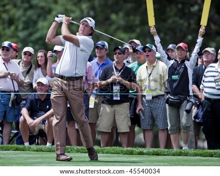 FARMINGDALE, NY - JUNE 17: Spectators enjoy watching Phil Mickelson hit a drive on the second hole at the black course during the 2009 US Open on June 17, 2009 in Farmingdale, NY.