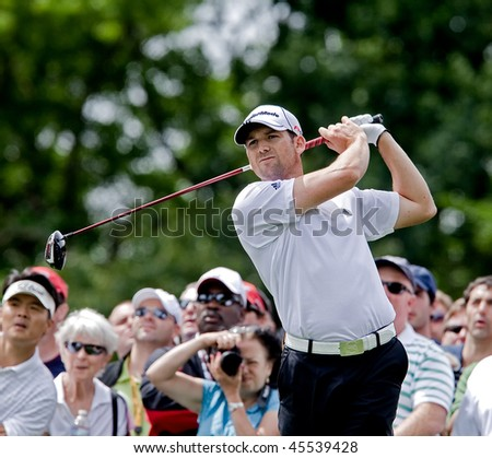 FARMINGDALE, NY - JUNE 17: Spectators enjoy watching Sergio Garcia hit a drive on the Sixth hole at the black course during the 2009 US Open on June 17, 2009 in Farmingdale, NY. - stock photo
