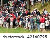 FARMINGDALE, , NY - JUNE 16: Spectators intensely watch and shoot images of Tiger Woods during a practice round at the 2009 US Open on June 16, 2009 in Farmingdale, NY. - stock photo