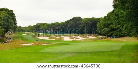 FARMINGDALE, NY - JUNE 16: The 4th on Bethpage State Park's black course at the 2009 US Open on June 16, 2009 in Farmingdale, NY. Designed by AW Tillinghast, this is open to the public for a low fee. - stock photo