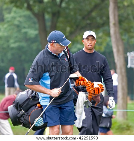FARMINGDALE, , NY - JUNE 16: Tiger Woods and his caddy, Steve Williams, walk off the 12th hole on the Black Course during the 2009 US Open on June 16, 2009 in Farmingdale, NY. - stock photo