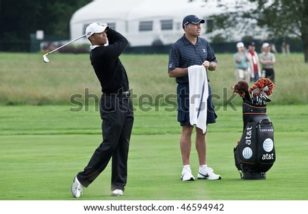 FARMINGDALE, , NY - JUNE 16: Tiger Woods and his caddy watch his second shot on the 16th hole on the Black Course during the 2009 US Open on June 16, 2009 in Farmingdale, NY. - stock photo