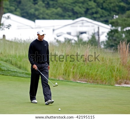 FARMINGDALE, , NY - JUNE 16: Tiger Woods has fun bouncing the golf ball off his putter on the Black Course during the 2009 US Open on June 16, 2009 in Farmingdale, NY. - stock photo